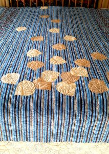 Close Up of the appliqued leaves in two fabrics on Falling Aspen Leaves King Quilt - available through Gallerie Quilts, Evergreen, Co