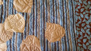 Quilting and applique detail for Falling Aspen Leaves