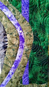 Quilting detail for Tree Pose, showing Balance between small circles (earth, stones) and circular (air) quilting.