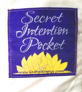Close up of the Secret Intention Pocket on back of quilts (trademark pending